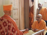 Swamishri engaged in darshan of Brahmaswarup Shastriji Maharaj