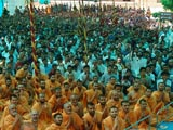 Sadhus and devotees engaged in Swamishri's darshan