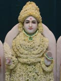Shri Ghanshyam Maharaj adorned in flowers