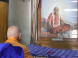 Swamishri engaged in darshan of Brahmaswarup Shastriji Maharaj at Rang Mandap