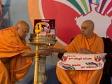 Swamishri lights the inaugural lamp for 'Akhil Bhartiya Yuva Adhiveshan'
