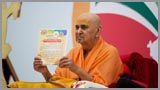 Swamishri sanctifies the certificate to be given to all winners