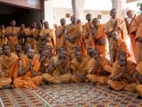 Sadhus engaged in darshan of Swamishri