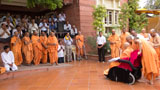 Sadhus and devotees doing Swamishri's darshan