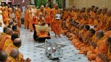 Sadhus sing kirtans and play musical instruments while doing darshan of Shri Harikrishna Maharaj and Swamishri