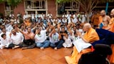 Devotees sing kirtans before Swamishri