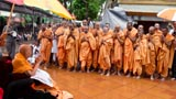 Sadhus doing darshan of Swamishri amidst rain