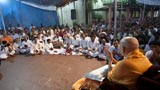Youths sing kirtan in the traditional 'ochhchhav' style