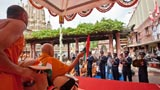BAPS youth from Nadiad play marching tunes in front of Swamishri