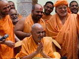 Swamishri with sadhus in the mandir pradakshina