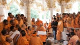 Swamishri with sadhus beneath the mandir dome