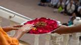 Swamishri sanctifies flowers and malas