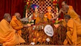 Sadhus honor Swamishri with a shawl of malas