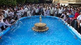 Devotees shower water from the pond on Nilkanth Varni as a form of abhishek