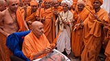 Swamishri in a festive mood with sadhus in the mandir pradakshina
