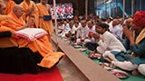 Swamishri blesses devotees who have gathered for darshan and participation in the murti pratishtha ceremony