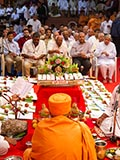 Senior sadhus perform mahapuja rituals during Chopda Pujan