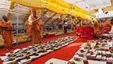 Senior sadhus perform pujan of account books by showering sanctified flower petals, rice grains, abil and gulal