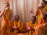 Sadhus blow the conch as an auspicious symbol to welcome the New Year