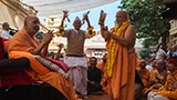 Pujya Ghanshyamcharan Swami plays kartals before Swamishri