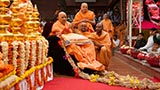 Senior sadhus honor Swamishri with a garland