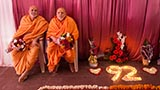 Pujya Ishwarcharan Swami and Pujya Viveksagar Swami welcome Swamishri with flowers