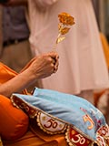 Swamishri sanctifies a decorative flower