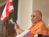 Swamishri waves BAPS flag