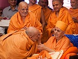 Pujya Viveksagar Swami being blessed by Swamishri