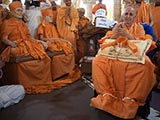 Swamishri with sadhus under the mandir dome