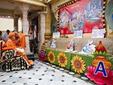 Swamishri observes a presentation on the life and work of Brahmaswarup Shastriji Maharaj, in the mandir pradakshina