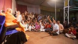 Swamishri blesses kids on the way to Sunday satsang assembly