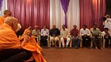 Swamishri blesses historians on the way to Sunday satsang assembly