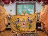 Swamishri is honored with shawls