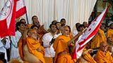 Senior sadhus wave BAPS flags