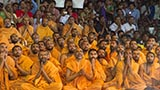 Sadhus and devotees engrossed in darshan of Swamishri