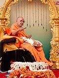 Swamishri sprays colored water