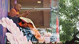 Swamishri sprays colored water towards sadhus and devotees
