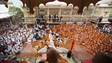 Youth and kids enjoy the celebrations with flower petals in the presence of Swamishri