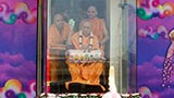 Swamishri blesses all by showering flower petals on Pushpadolotsav