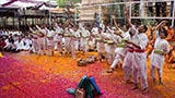 Youth enjoy the celebrations with flower petals in the presence of Swamishri