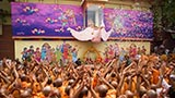 Sadhus enjoy the celebrations with flower petals in the presence of Swamishri
