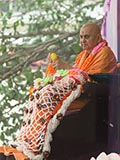 Swamishri is garlanded with a 'chaadar' of flowers