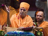 Swamishri blesses devotees by showering flower petals