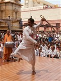 A devotee performs a folk dance before Swamishri