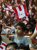A kid waves the BAPS flag