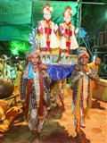 A procession of murtis carried by youths