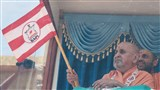 Swamishri waves the BAPS flag