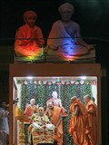 Swamishri offers sweets to devotees