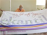 Swamishri is honored with a shawl